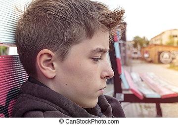 portrait of a teenage boy in profile
