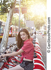 portrait of a teenage girl on a bicycle in Barcelona