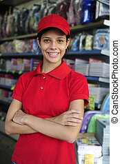 teenage girl working part time in a stationery shop - ...