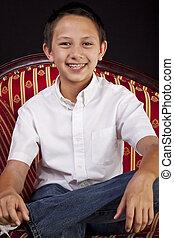 Portrait of a Teenaged Boy on Sofa - Formal posed portrait...