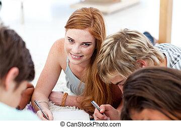 Portrait of a teenagers doing homework