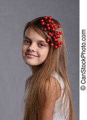Portrait of a ten year old girl with a bunch of berries in her hair