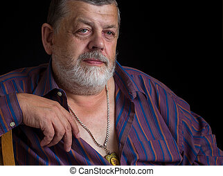 Portrait of a thoughtful senior man in striped shirt