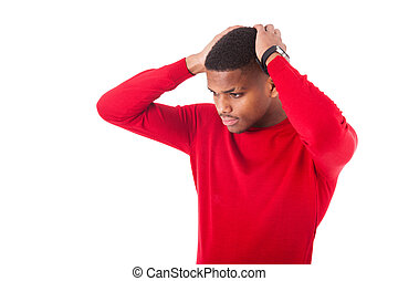Portrait of a thoughtful young african american man isolated on white background