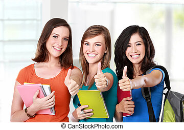 female student together showing thumbs up