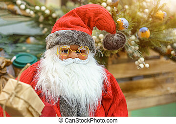 Portrait of a toy Santa Claus, new year's holiday concept