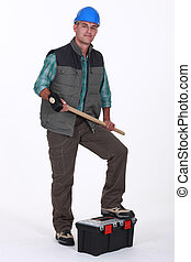 Portrait of a tradesman holding a mallet