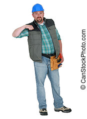 Portrait of a tradesman holding his arm up