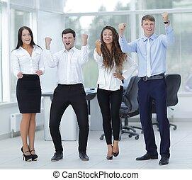 portrait of a triumphant business team