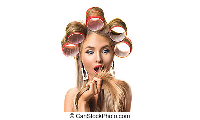 Portrait of a upset woman with hair curlers on her head