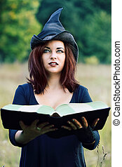 Portrait of a witch with a book