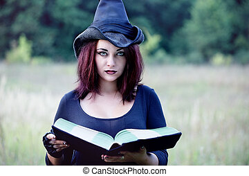 Portrait of a witch with a book, close-up