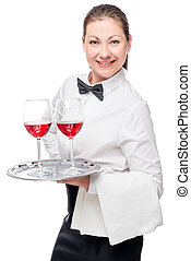 portrait of a woman - a waitress with glasses of wine on a white background in studio