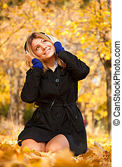 Portrait of a woman at outdoor with headphones.