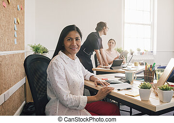 Portrait Of A Woman At Work - Portrait of a female employee...