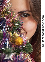 behind a christmas tree