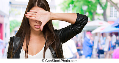 Portrait of a Woman Covering Her Eyes