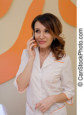 Portrait of a woman doctor cosmetologist