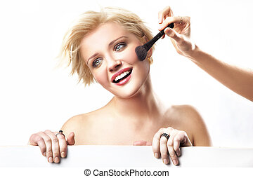 Portrait of a woman doing make up