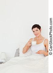 Portrait of a woman drinking tea