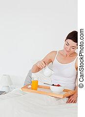 Portrait of a woman having breakfast