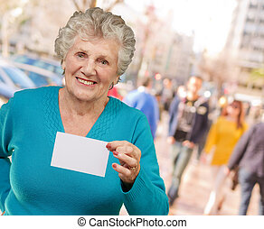Portrait Of A Woman Holding Blank Paper