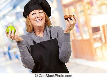 Portrait Of A Woman Holding Fruit