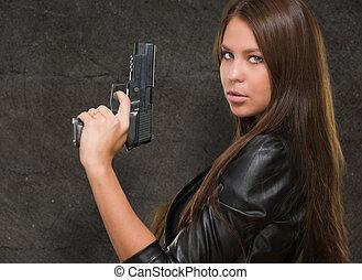 Portrait Of A Woman Holding Gun