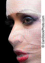 portrait of a woman in a bandage