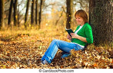 Portrait of a woman in autumn park