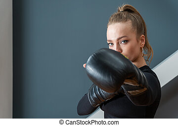 portrait of a woman in boxing gloves