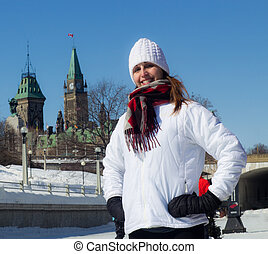 Portrait of a woman in front of Canada Parliament Hill in winter