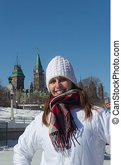 Portrait of a woman in front of the Canadian Parliament Hill in