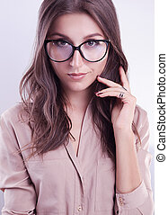 Portrait of a woman in glasses on white background