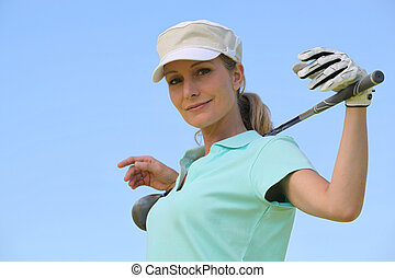 portrait of a woman in golf clothes