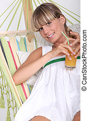 portrait of a woman in hammock