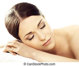 Portrait of a woman in spa. Massage healing procedure.
