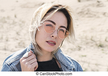 Portrait of a woman in sunglasses