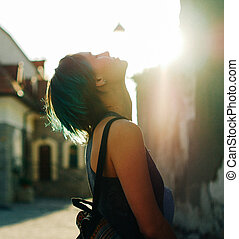 portrait of a woman in the old town at sunset.