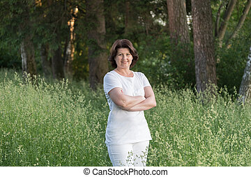 Portrait of a woman in white clothes on the nature