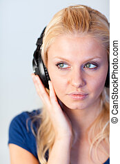 Portrait of a woman listening music with headphones