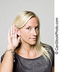 Portrait of a woman listening