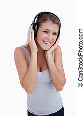 Portrait of a woman listening to music