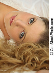 Portrait of a woman lying down
