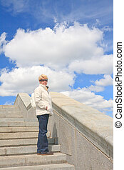 Portrait of a woman of retirement age on the stairs