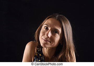 portrait of a woman on black background