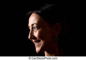 portrait of a woman on black