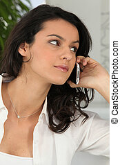 Portrait of a woman on phone looking away