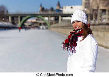 Portrait of a woman on the Ottawa Rideau Canal Skateway during w