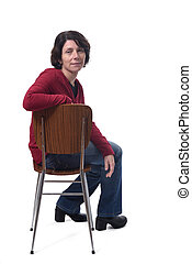 portrait of a woman sitting on a chair on white background,